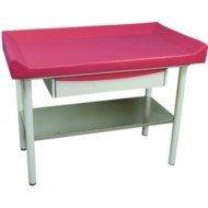 Table de pédiatrie Promotal - Le divan à têtière réglable par système mécanique.